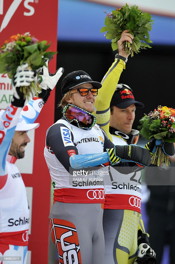 Second placed France's Gauthier De Tessieres (L) (L), Winner US Ted Ligety (C), and third placed Norway's Alsel Lund Svindal celebrate on the podium after the men's Super-G event of the 2013 Ski World Championships in Schladming, Austria on February 6, 2013.