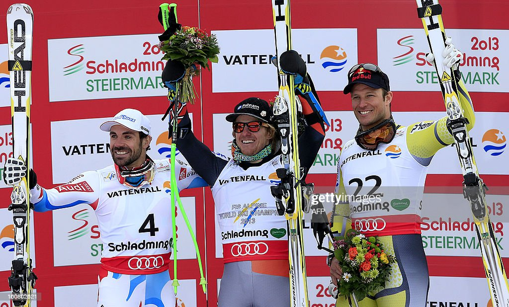Second placed France's Gauthier De Tessieres, winner US Ted Ligety, and third placed Norway's Alsel Lund Svindal celebrates during the podium ceremony after the men's Super-G event of the 2013 Ski World Championships in Schladming, Austria on February 6, 2013.