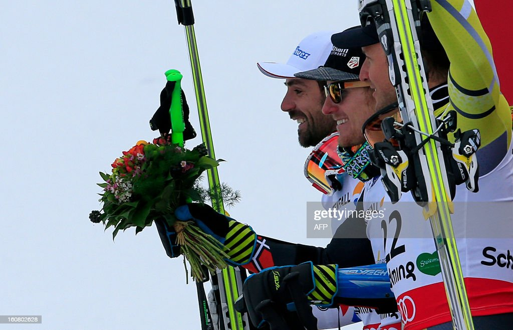 Second placed France's Gauthier De Tessieres, winner US Ted Ligety, and third placed Norway's Alsel Lund Svindal celebrates during the podium ceremony after the men's Super-G event of the 2013 Ski World Championships in Schladming, Austria on February 6, 2013. AFP PHOTO / ALEXANDER KLEIN