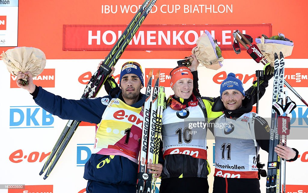 Second placed France's Martin Fourcade, winner Czech's Ondrej Moravec and Germany's third placed Erik Lesser pose on the podium after the men's 15 km mass start race Biathlon World Cup in Oslo on March 3, 2013.