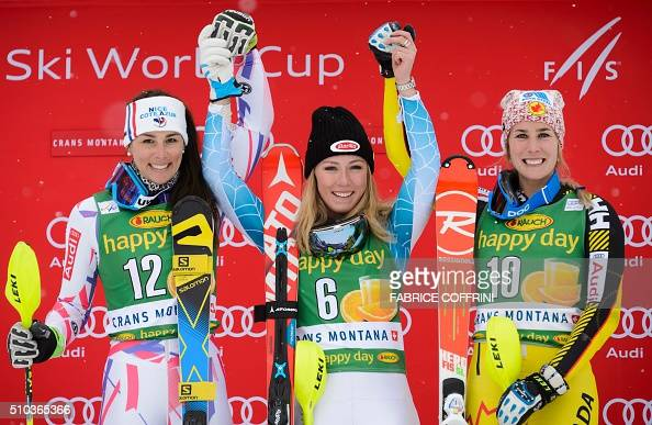Second placed France's Nastasia Noens winner Mikaela Shiffrin of the US and third placed Canada's MarieMichele Gagnon pose during the podium ceremony...