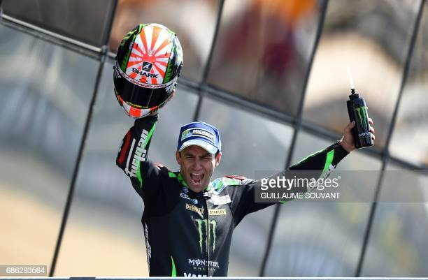 Second placed France's rider Johann Zarco jubilates on the podium after the MotoGP race of the French Motorcycle Grand Prix on May 21 2017 in Le Mans...