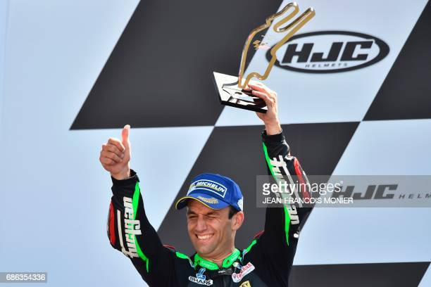 Second placed France's rider Johann Zarco of a Monster Yamaha TECH 3 MOTOGP N°5 celebrates on the podium during the trophy ceremony after competing...