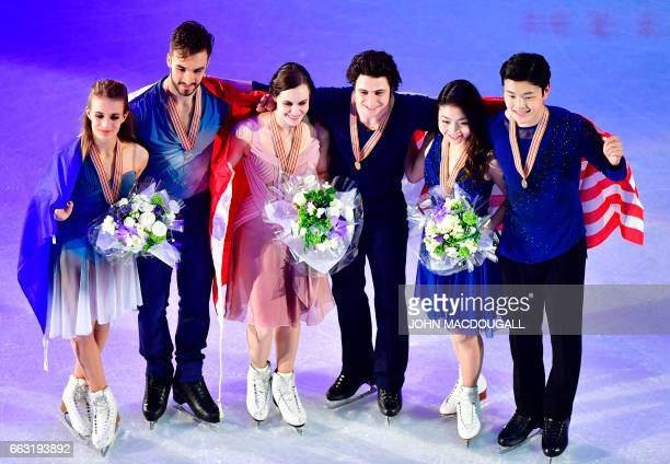 Second placed Gabriella Papadakis and Guillaume Cizeron of France winners Tessa Virtue and Scott Moir of Canada and third placed Maia Shibutani and...
