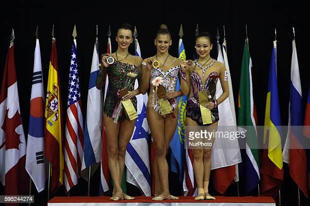 Second placed Ganna Rizatdinova of Ukraine Winner Aleksandra Soldatova of Russia and Third placed Yeon Jae Son of Korea in the podium after the hoop...