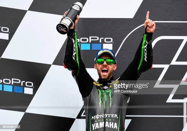 Second placed German Yamaha rider Jonas Folger celebrates after the MotoGP competition of the Moto Grand Prix of Germany at the Sachsenring Circuit...