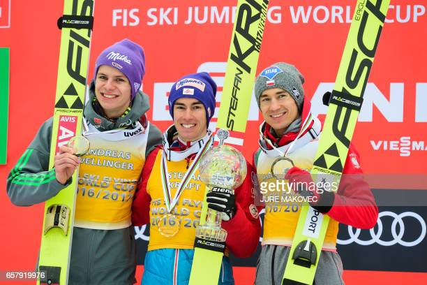 Second placed Germany's Andreas Wellinger winner of teh Ski Flying World Cup Austria's Stefan Kraft and third placed Poland's Kamil Stoch pose for...
