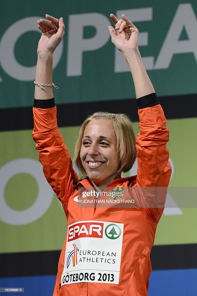 Second placed Germany's Corinna Harrer celebrates on the podium after the Women's 3000m Final event at the European Indoor athletics Championships in Gothenburg, Sweden, on March 3, 2013.