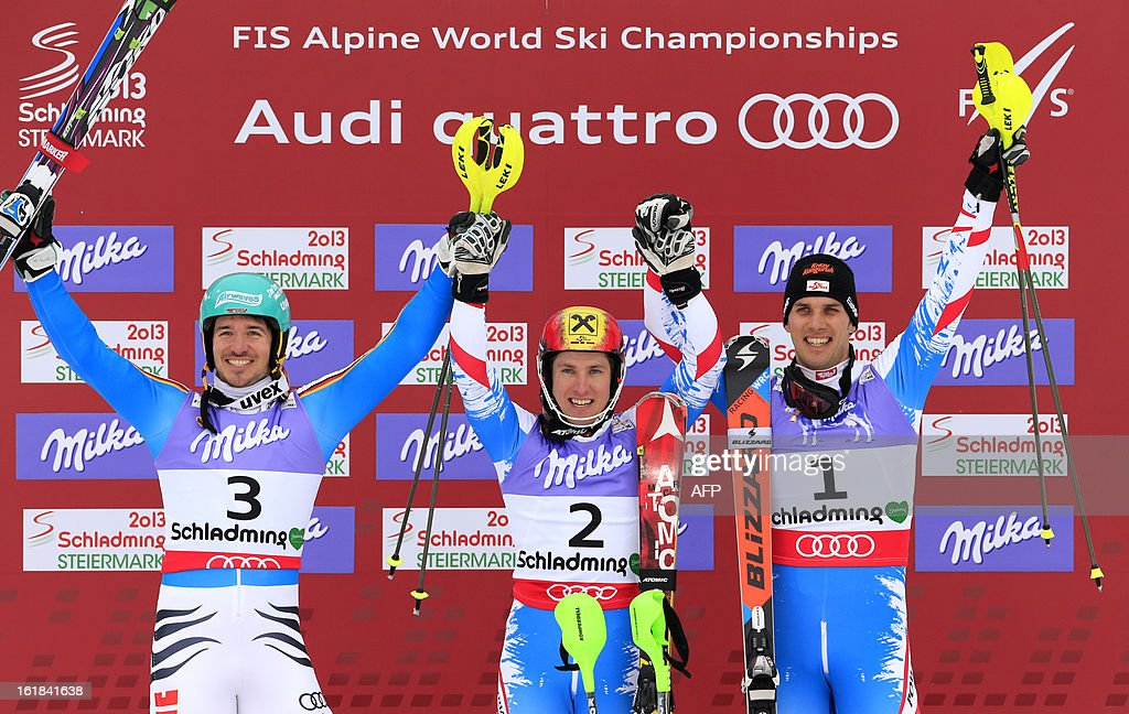 Second placed Germany's Felix Neureuther, winner Austria's Marcel Hirscher and Austria's Mario Matt celebrate on the podium after the men's slalom at the 2013 Ski World Championships in Schladming, Austria on February 17, 2013.