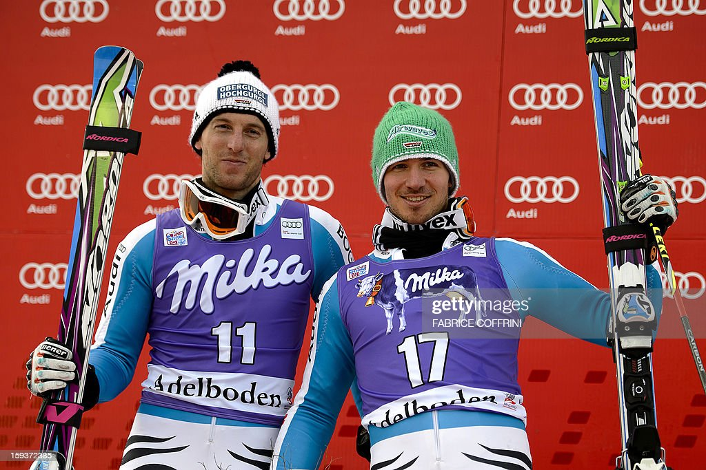 Second placed Germany's Fritz Dopfer (L) poses with third placed compatriot Felix Neureuther during the podium ceremony of the Men's giant slalom at the Alpine Skiing World Cup on January 12, 2013 in Adelboden. Ted Ligety of the US claimed victory, safely negotiating a testing second leg that was the downfall of a raft of racers. AFP PHOTO / FABRICE COFFRINI