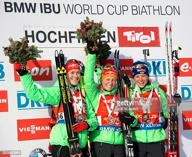 Second placed Germany's Maren Hammerschmidt winner Germany's Franziska Hildebrand and third placed Germany's Miriam Goessner celebrate on the podium...