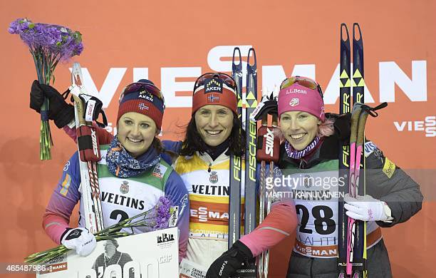Second placed Ingvild Flugstad Ostberg of Norway Winner Marit Bjorgen of Norway and third placed Kikkan Randall of USA celebrating after FIS World...