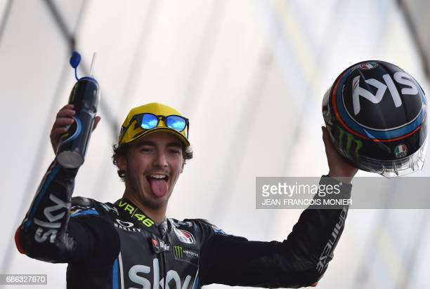 Second placed Italy's rider Francesco Bagnaia celebrates on the podium after the Moto2 race of the French Motorcycle Grand Prix on May 21 2017 in Le...