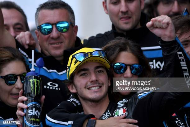 Second placed Italy's rider Francesco Bagnaia celebrates with his team after the Moto2 race of the French Motorcycle Grand Prix on May 21 2017 in Le...