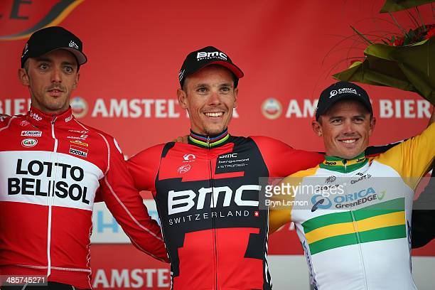 Second placed Jelle Vanendert of Belgium and Lotto Belisol winner Philippe Gilbert of Belgium and BMC Racing Team and third placed Simon Gerrans of...