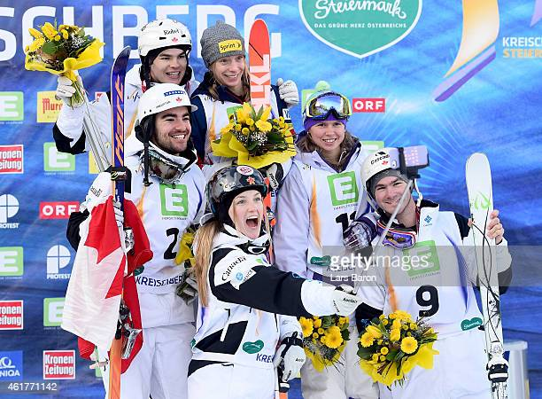 Second placed Justine DufourLapointe of Canada takes a selfie of Mikael Kingsbury of Canada MarcAntoine Gagnon of Canada Philippe Marquis of Canada...