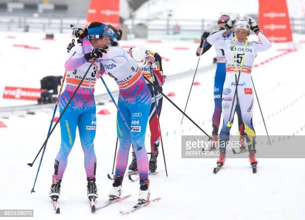 Second placed Krista Parmakoski hugs her compatriot third placed Kerttu Niskanen after the Women's 30km C Mass Start cross country event of the FIS...