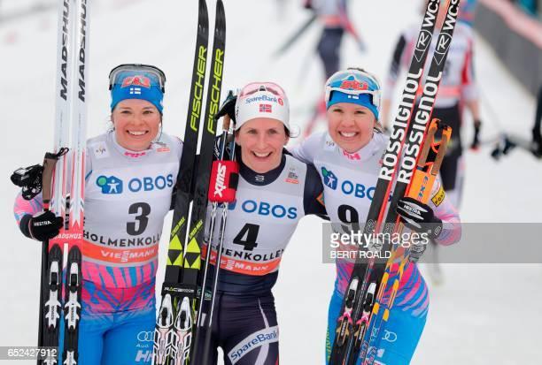 Second placed Krista Parmakoski of Finland winner Marit Bjoergen of Norway and third placed Kerttu Niskanen of Finland pose after the Women's 30km C...