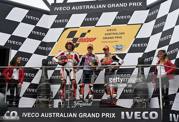 Second placed Marco Simoncelli of Italy and San Carlo Honda Gresini winner Casey Stoner of Australia and Repsol Honda Team and third placed Andrea...