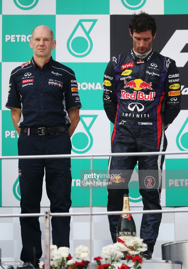 Second placed <a gi-track='captionPersonalityLinkClicked' href=/galleries/search?phrase=Mark+Webber+-+Coureur+automobile&family=editorial&specificpeople=167271 ng-click='$event.stopPropagation()'>Mark Webber</a> (L) of Australia and Infiniti Red Bull Racing and Infiniti Red Bull Racing Chief Technical Officer <a gi-track='captionPersonalityLinkClicked' href=/galleries/search?phrase=Adrian+Newey&family=editorial&specificpeople=215410 ng-click='$event.stopPropagation()'>Adrian Newey</a> (R) react on the podium following the Malaysian Formula One Grand Prix at the Sepang Circuit on March 24, 2013 in Kuala Lumpur, Malaysia.