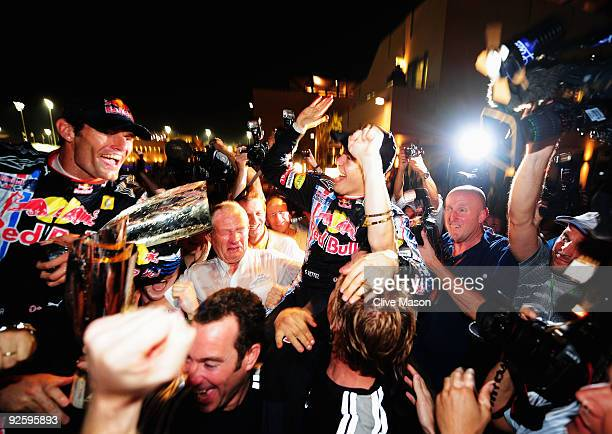 Second placed Mark Webber of Australia and Red Bull Racing and race winner Sebastian Vettel of Germany and Red Bull Racing celebrate with team mates...