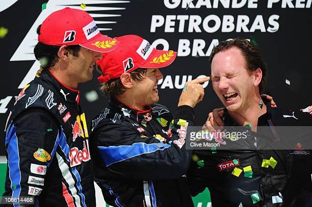 Second placed Mark Webber of Australia and Red Bull Racing race winner Sebastian Vettel of Germany and Red Bull Racing and Red Bull Racing Team...