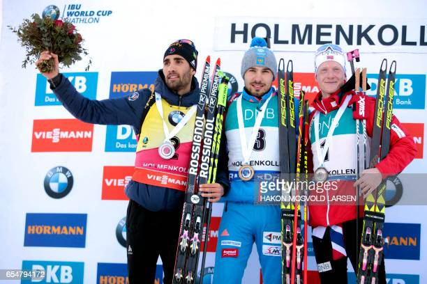 Second placed Martin Fourcade from France winner Anton Shipulin from Russia and third placed Johannes Thingnes Boe pose on the podium after IBU...