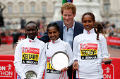 Second placed Mary Keitany of Kenya first placed Tigist Tufa of Kenya Prince Harry and third placed Tirfi Tsegaye of Ethiopia pose for the cameras...