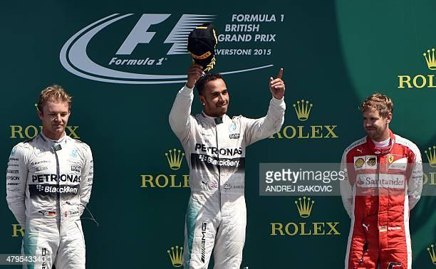 Second placed Mercedes AMG Petronas F1 Team's German driver Nico Rosberg winner Mercedes AMG Petronas F1 Team's British driver Lewis Hamilton and...