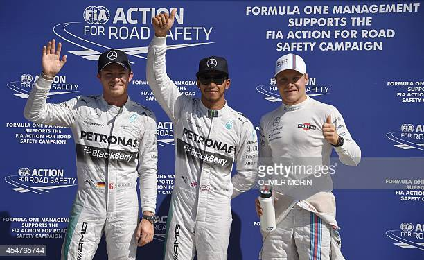 Second placed Mercedes' German driver Nico Rosberg first placed Mercedes' British driver Lewis Hamilton and third placed Williams' Finnish driver...