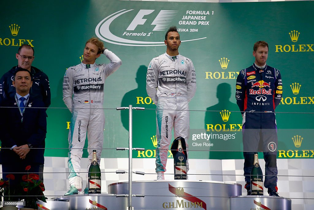 Second placed Nico Rosberg of Germany and Mercedes GP race winner Lewis Hamilton of Great Britain and Mercedes GP and third placed Sebastian Vettel...