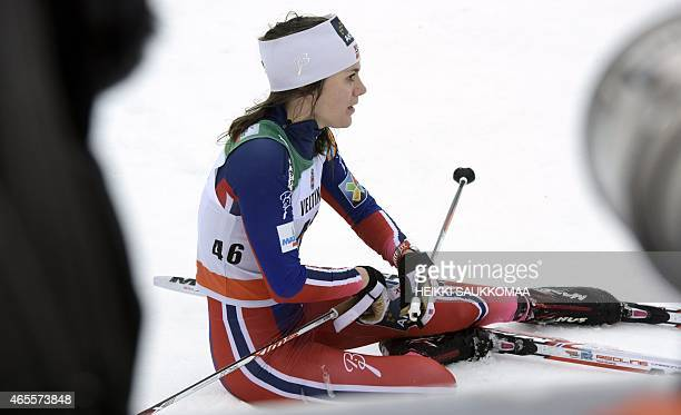 Second placed Norway's Heidi Weng reacts at finish after the Ladies' FIS World Cup 10km classic style cross country skiing competition in Lahti Ski...