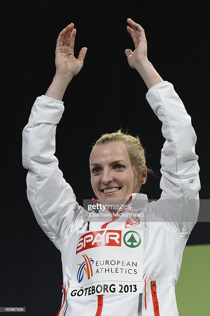 Second placed Poland's Anna Rogowska celebrates on the podium after the women's Pole Vault final at the European Indoor athletics Championships in Gothenburg, Sweden, on March 2, 2013.