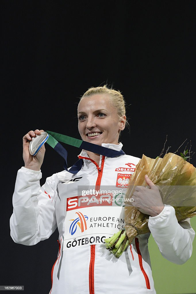 Second placed Poland's Anna Rogowska celebrates with her silver medal on the podium after the women's Pole Vault final at the European Indoor athletics Championships in Gothenburg, Sweden, on March 2, 2013. AFP PHOTO / JONATHAN NACKSTRAND