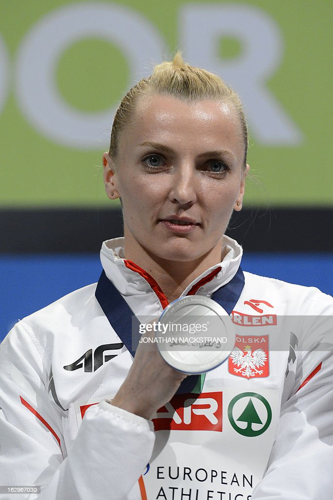Second placed Poland's Anna Rogowska celebrates with her silver medal on the podium after the women's Pole Vault final at the European Indoor athletics Championships in Gothenburg, Sweden, on March 2, 2013.