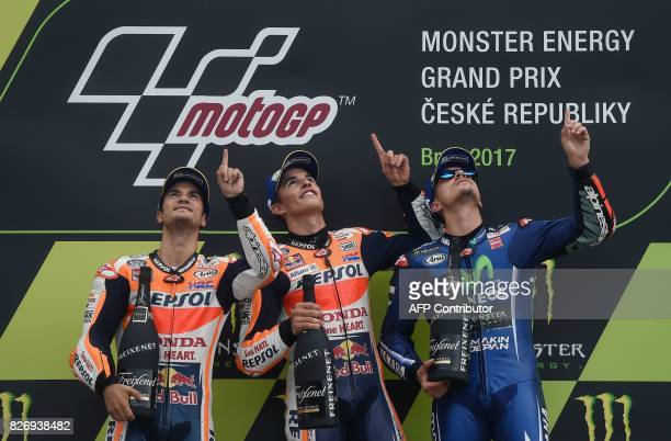 TOPSHOT Second placed Repsol Honda Team's Spanish rider Dani Pedrosa winner Repsol Honda Team's Spanish rider Marc Marquez and third placed Movistar...