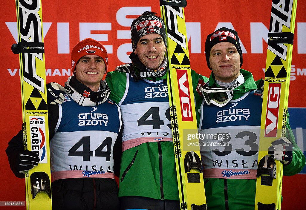Second placed Richard Freitag from Germany, winner Anders Bardal from Norway and third placed Rune Velta from Norway pose on the podium of the 14th FIS World cup competition, on January 9, 2013 in Wisla.