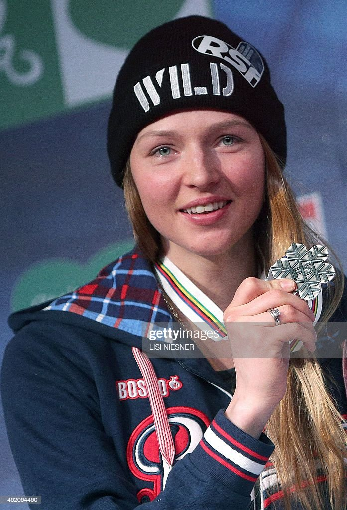 Second placed Russia's <a gi-track='captionPersonalityLinkClicked' href=/galleries/search?phrase=Alena+Zavarzina&family=editorial&specificpeople=6598104 ng-click='$event.stopPropagation()'>Alena Zavarzina</a> celebrates on the podium after she received her silver medal for the Women's Snowboard Parallel Giant Slalom Finals of FIS Freestyle and Snowboarding World Ski Championships 2015 in Kreischberg on January 23, 2015. AFP PHOTO / LISI NIESNER
