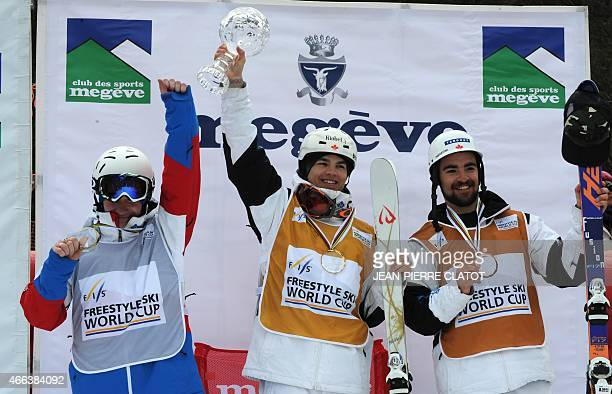 Second placed Russia's Alexandr Smyshlyaev winner of the Chrystal Globe Canada's Mikael Kingsbury and third placed Canada's Philippe Marquis...