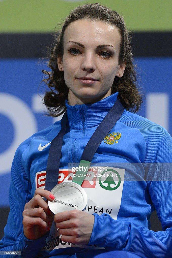 Second placed Russia's Irina Gumenyuk celebrates with her silver medal on the podium after the Women's Triple Jump Final at the European Indoor athletics Championships in Gothenburg, Sweden, on March 3, 2013.