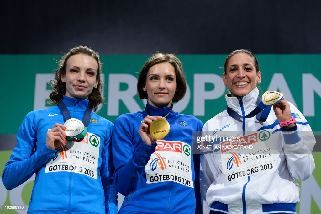 Second placed Russia's Irina Gumenyuk, winner Ukraine's Olha Saladuha and third placed Italy's Simona La Mantia celebrate with their medals on the podium after the Women's Triple Jump Final at the European Indoor athletics Championships in Gothenburg, Sweden, on March 3, 2013.