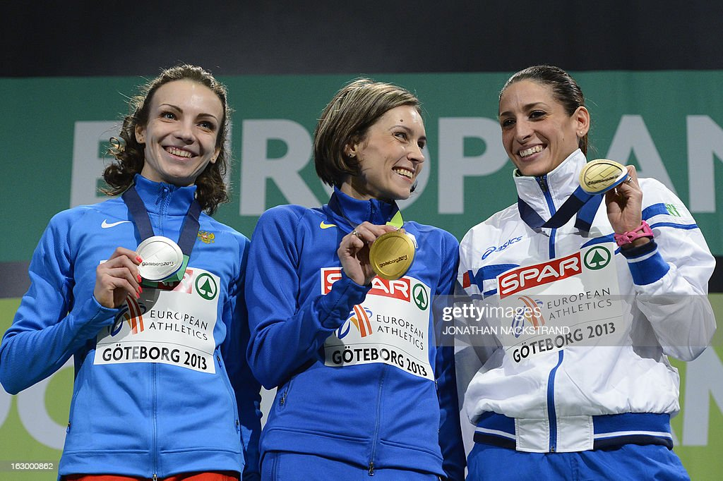 Second placed Russia's Irina Gumenyuk, winner Ukraine's Olha Saladuha and third placed Italy's Simona La Mantia celebrate with their medals on the podium after the Women's Triple Jump Final at the European Indoor athletics Championships in Gothenburg, Sweden, on March 3, 2013. AFP PHOTO / JONATHAN NACKSTRAND