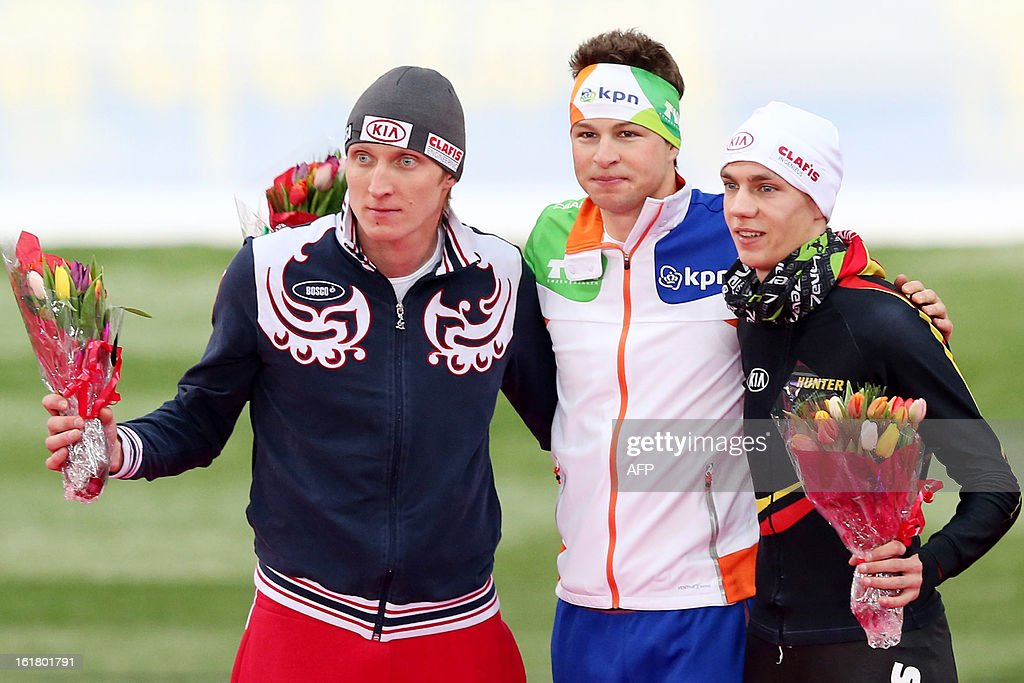 Second placed Russia's Ivan Skobrev, winner the Nehterlands' Sven Kramer and third placed Belgium's Bart Swings pose on the podium after the 5000m Men event of the World Speedskating Championships on February 16, 2013 in Hamar, Central Norway. AFP PHOTO / Hakon Mosvold Larsen +++ NORWAY OUT