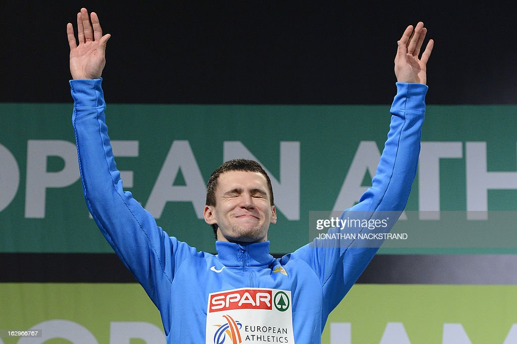 Second placed Russia's Ruslan Samitov celebrates on the podium after the men's Triple Jump Final at the European Indoor athletics Championships in Gothenburg, Sweden, on March 2, 2013.