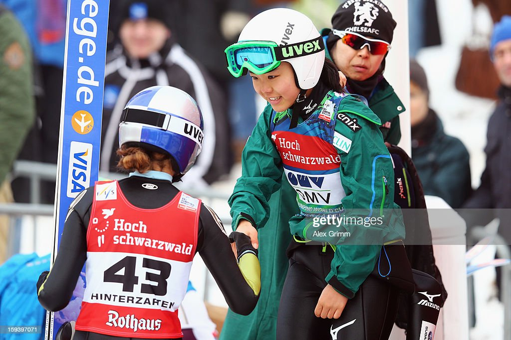 Second placed Sarah Hendrickson (L) of the USA congratulates winner Sara Takanashi of Japan during the FIS Ski Jumping World Cup Women's HS108 on January 13, 2013 in Titisee-Neustadt, Germany.