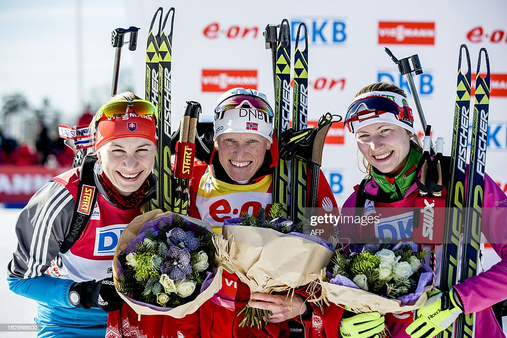 Second placed Slovakia's Anastasiya Kuzmina, Norway's winner Tora Berger and third placed Belarus Darya Domracheva pose for photographers after the women's 12,5 km mass start race at the Biathlon World Cup in Oslo on March 3, 2013. AFP PHOTO / STIAN LYSBERG SOLUM / SCANPIX NORWAY / NORWAY OUT