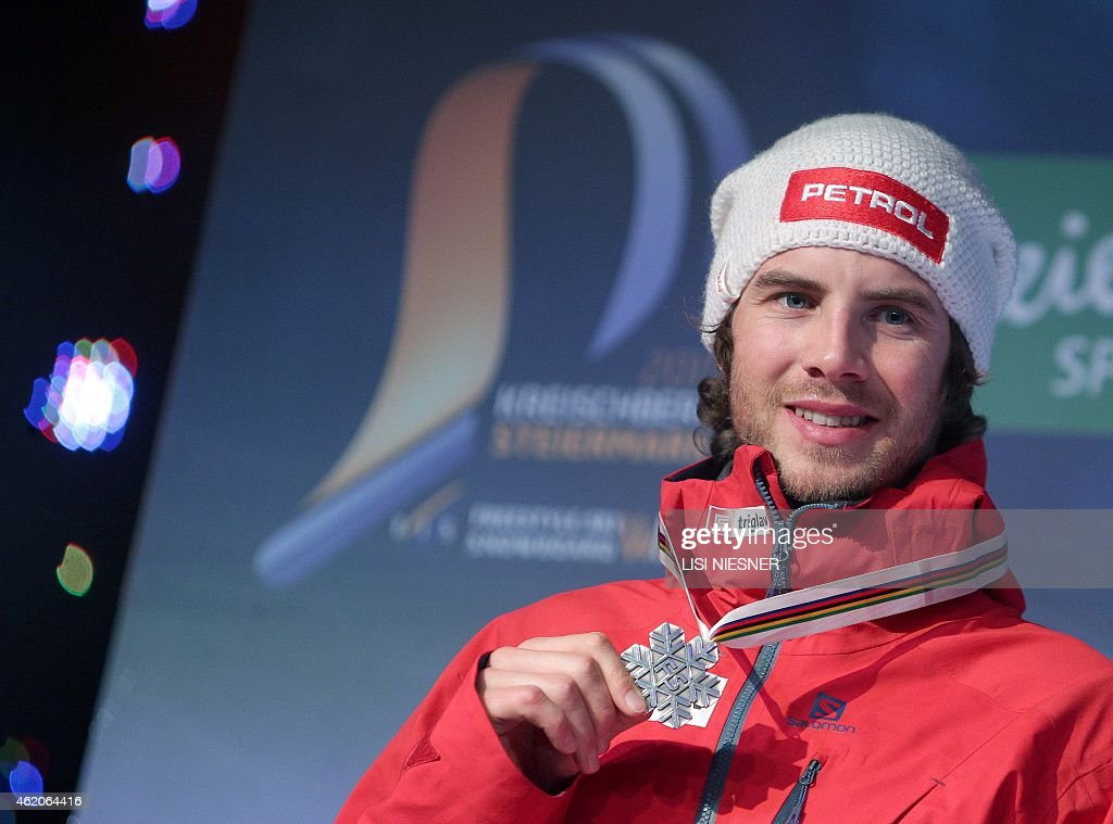 Second placed Slovenia's Zan Kosir celebrates on the podium after he received his silver medal for the Men's Snowboard Parallel Giant Slalom of FIS Freestyle and Snowboarding World Ski Championships 2015 in Kreischberg on January 23, 2015.