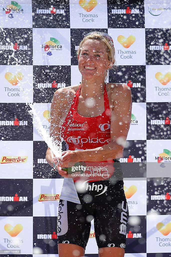 Second placed Sofie Goos sprays champagne following the women's competition in the Ironman 70.3 Mallorca on May 10, 2014 in Mallorca, Spain.