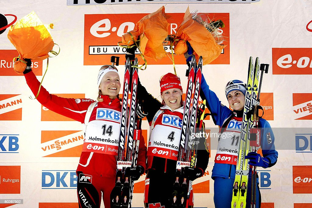 Second placed Solveig Rogstad of Norway, first placed Kati Wilhelm of Germany and third placed Michela Ponza of Italy are pictured on the podium after the women's 12.5 km mass start at the World Cup Biathlon ski race on March 16, 2008 in Oslo.