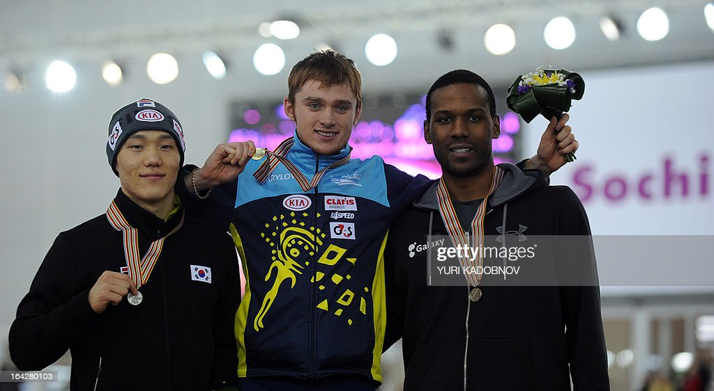 Second placed South Korea's Tae-Bum Mo, winner Kazakhstan's Denis Kuzin and third placed US Shani Davis stand on the podium after the 1000m men event of the 2013 World Single Distances Speed Skating Championships in Sochi on March 22, 2013. AFP PHOTO / YURI KADOBNOV